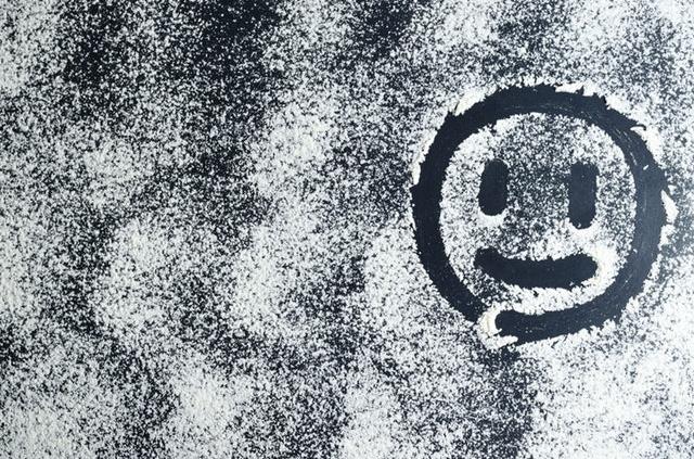 A Smiley drawn in white powder.